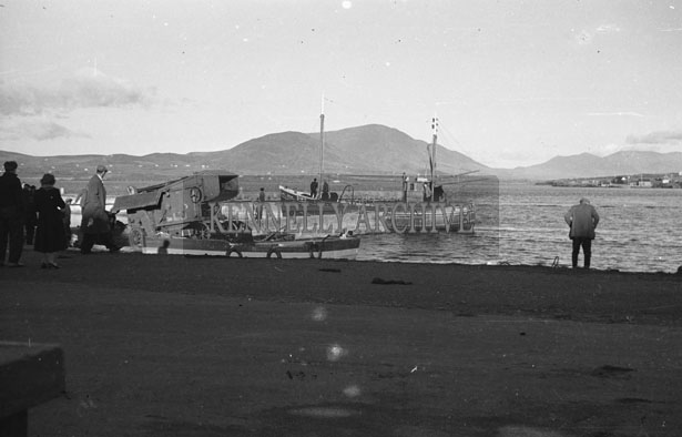 1953; A Photo Of A Boat And Workers At Valentia Pier.