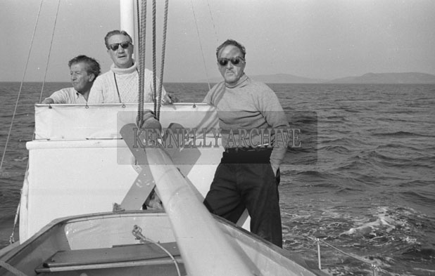 1953; Three Men Enjoying Themselves On A Boat Trip Off Valentia Island.