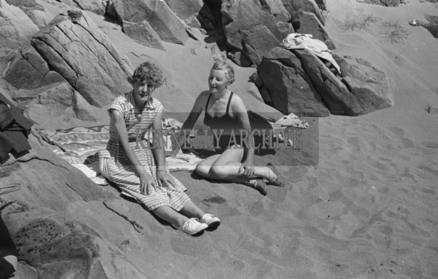 1953; Two Ladies Relaxing On The Beach On Valentia Island.
