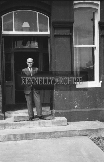 1953; A Man Standing Outside A Building On Valentia Island.