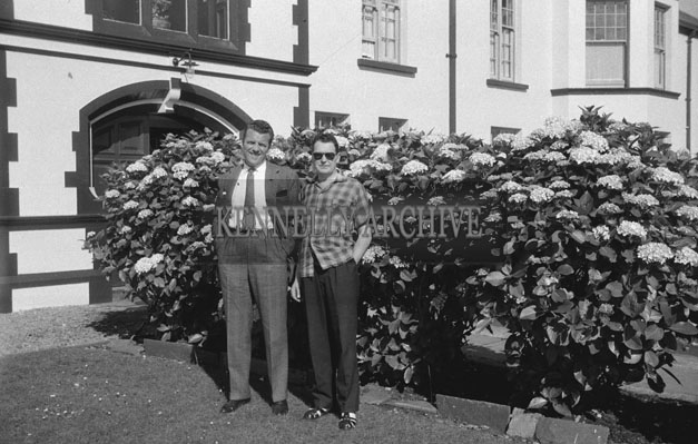 1953; Eamonn Andrews (left) with a friend Standing Outside The Royal Hotel On Valentia Island.