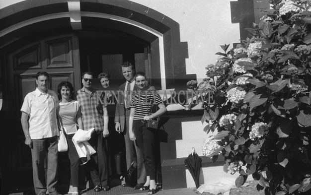 1953; Norman Ross (left) and Eamonn Andrews (third from right) with a group Standing Outside The Royal Hotel On Valentia Island.