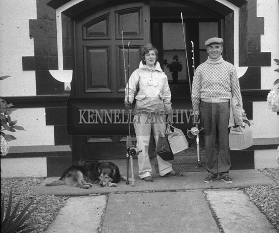 1953; A Lady And A Man Standing Outside The Royal Hotel With Fishing Gear On Valentia Island.