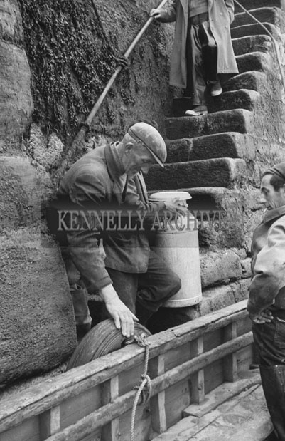 1953; Men Unloading Milk Churns From The Ferry On Valentia Island.