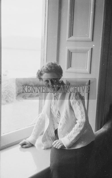 1953; A Woman Sitting By The Window Indoors On Valentia Island.