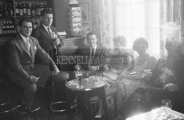 1953; Eamonn Andrews (centre) with a Group Of People In The Bar Of The Royal Hotel On Valentia Island.