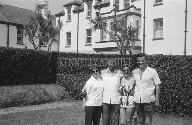 1953; A Photo Of Eamonn and Grainne Andrews with Norman Ross (centre) In The Garden Of The Royal Hotel On Valentia Island.