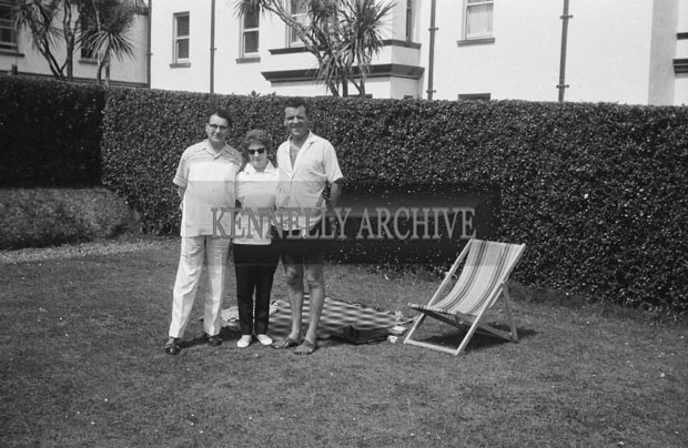 1953; Television star Eamon Andrews (right) with a couple Posing For The Camera In The Garden Of The Royal Hotel On Valentia Island.