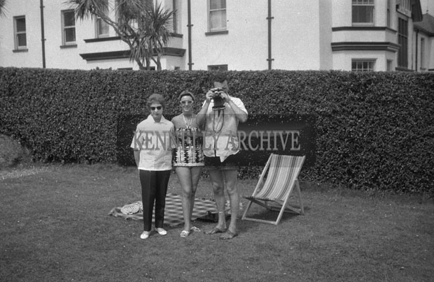 1953; Television star Eamon and Grainne Andrews (right) with a woman Posing For The Camera In The Garden Of The Royal Hotel On Valentia Island.
