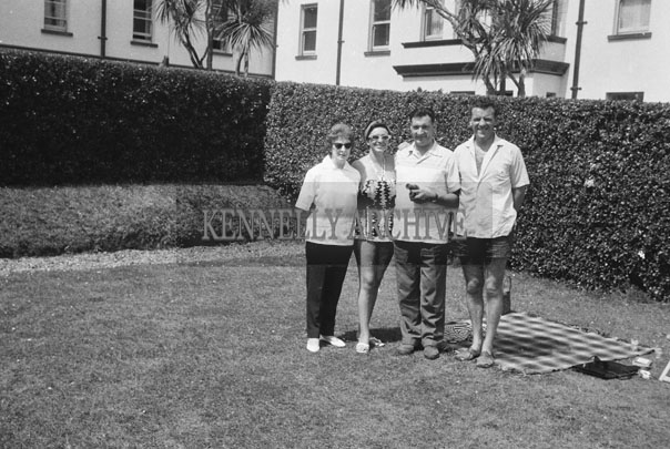 1953; Norman Ross (centre) with Eamonn and Grainne Andrews In The Garden Of The Royal Hotel On Valentia Island.
