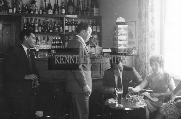 1953; Eamonn Andrews (seated) with a Group Of People In The Bar Of The Royal Hotel On Valentia Island.