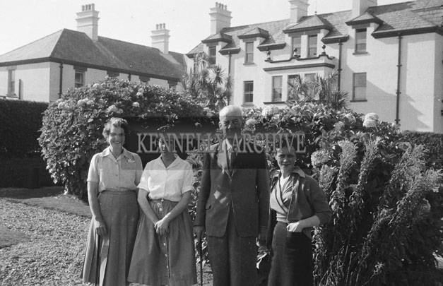 1953; A Group Of People Posing For The Camera In The Garden Of The Royal Hotel On Valentia Island.