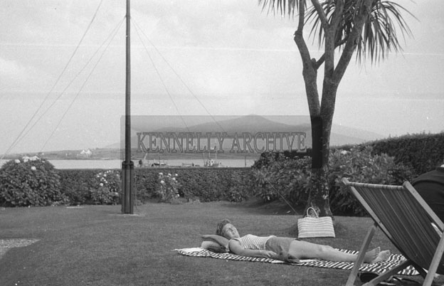 1953; A Photo Of A Lady Relaxing In The Garden Of The Royal Hotel On Valentia Island.