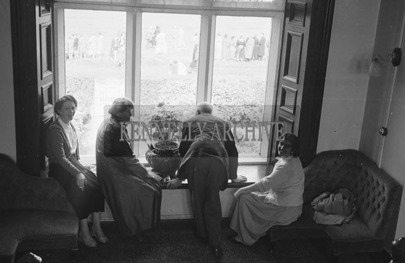 1953; A Group Looking Out The Window In The Royal Hotel On Valentia Island.