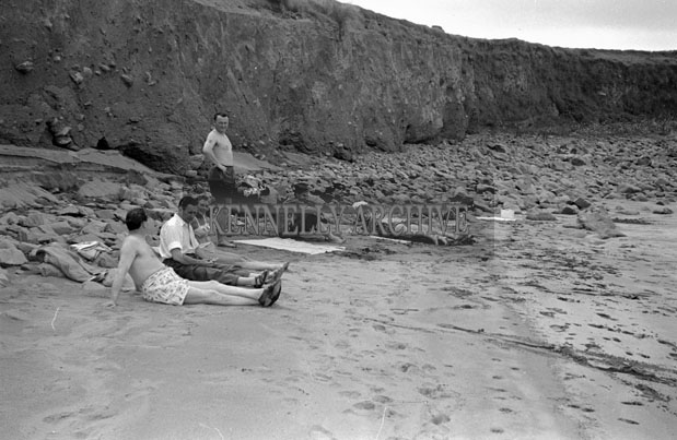 1953; A Group Of People Relaxing On The Beach At Valentia Island.