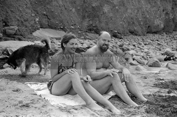 1953; A Couple Relaxing On The Beach At Valentia Island.