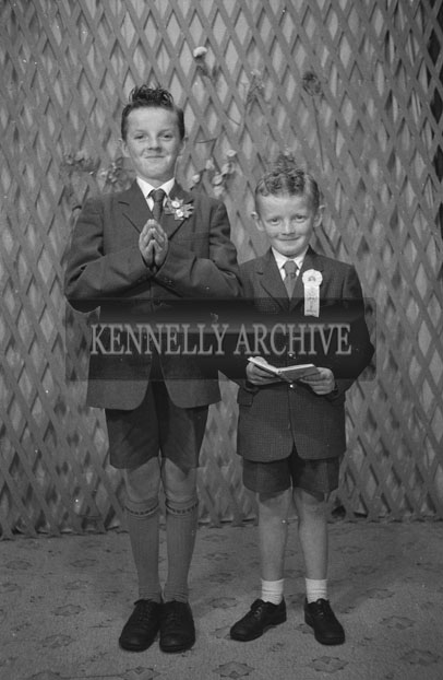 1953; A Studio Photo Of A Confirmation Boy And A Communion Boy Posing For The Camera.