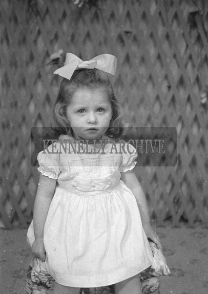 1953; A Studio Photo Of A Young Girl.