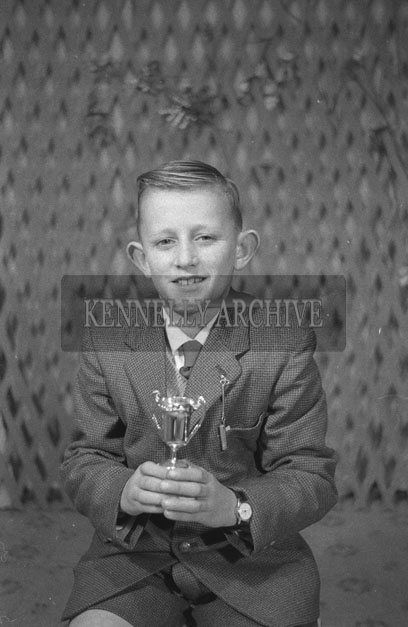 1953; A Studio Photo Of A Boy With A Trophy.