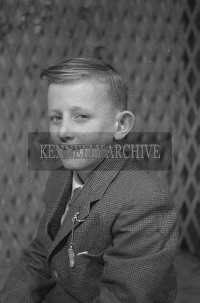 1953; A Studio Photo Of A Boy.