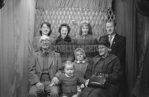 1953; A Studio Photo Of A Family.