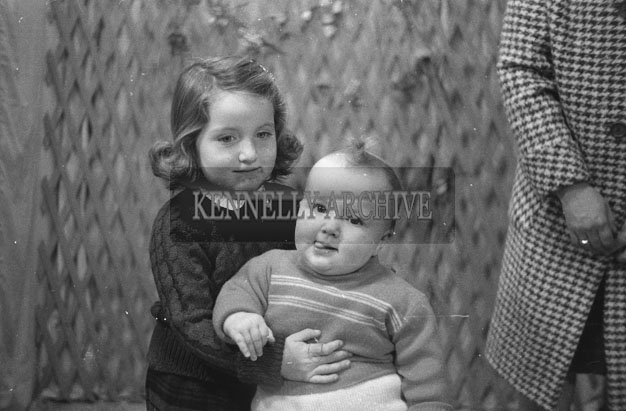 1953; A Studio Photo Of Two Young Children.