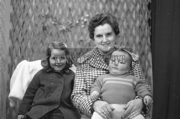 1953; A Studio Photo Of A Mother With Two Young Children.