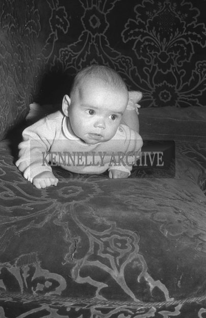 1953; A Photo Of A Baby Lying On A Chair At Home.