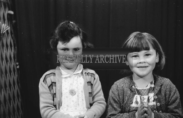 1953; A Studio Photo Of Two Young Girls Posing For The Camera.