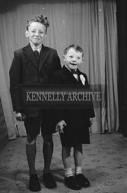 1953; A Studio Photo Of A Communion Boy And His Brother.