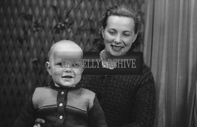 1953; A Studio Photo Of A Mother And Baby.