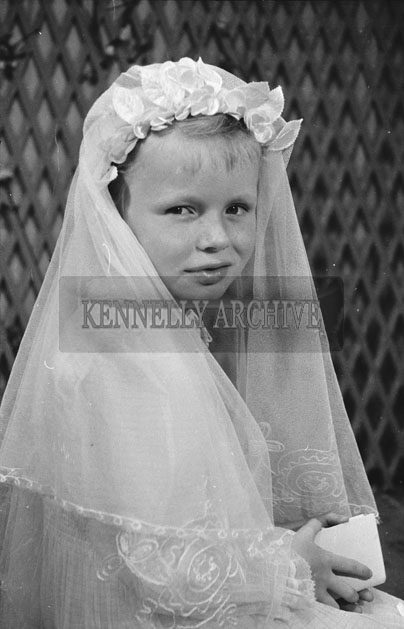 1953; A Studio Photo Of A Communion Girl Posing For The Camera.
