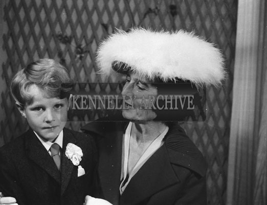 1953; A Studio Photo Of A Communion Boy Posing For The Camera With His Mother.