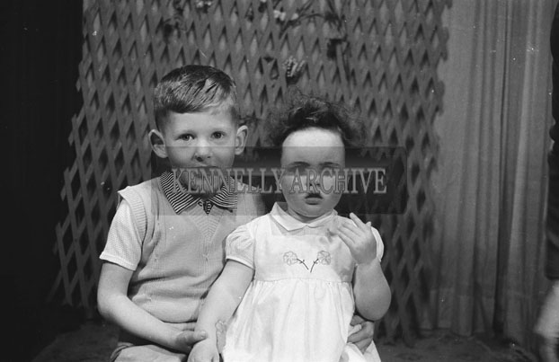 1953; A Studio Photo Of Two Young Children