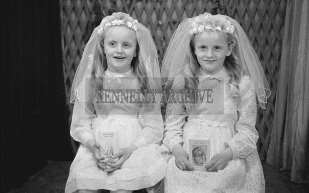 1953; A Studio Photo Of Twin Communion Girls Posing For The Camera.