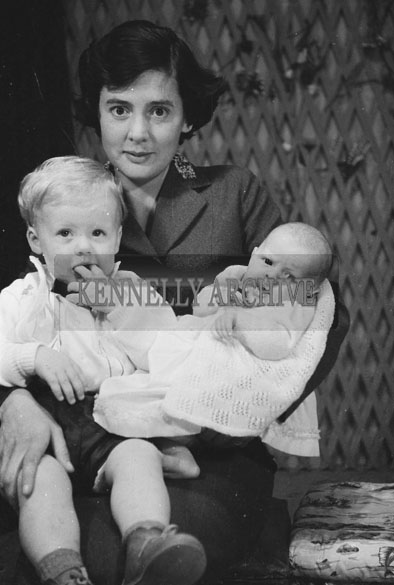 1953; A Studio Photo Of A Mother And Her Children.