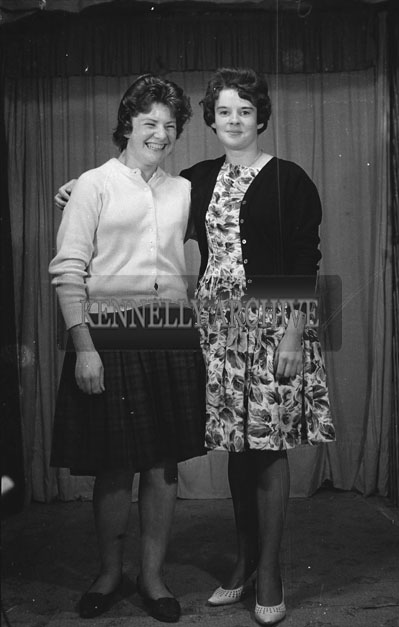 1953; A Studio Photo Of Two Smiling Women.