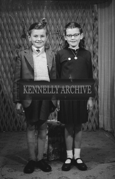 1953; A Studio Photo Of A Confirmation Girl Posing For The Camera With Her Brother.