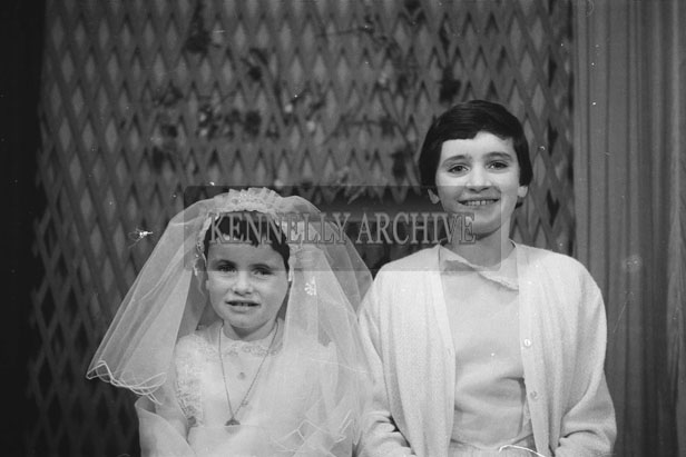 1953; A Studio Photo Of A Communion Girl And A Confirmation Girl Posing For The Camera.
