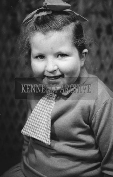 1953; A Studio Photo Of A Young Girl Posing For The Camera.