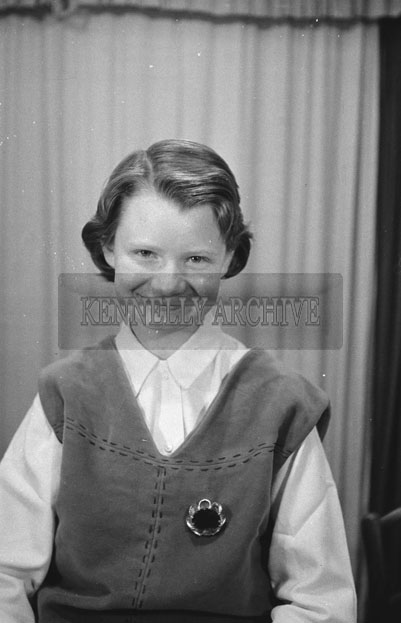 1953; A Studio Photo Of A Girl Posing For The Camera.