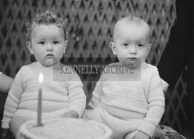 1953; A Studio Photo Of One Year Old Twins Posing With Their Cake On Their Birthday.