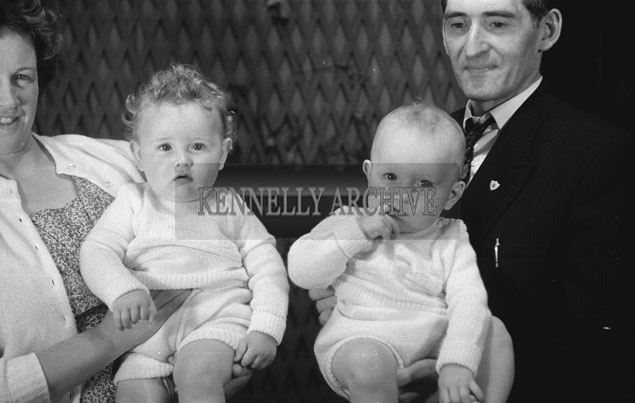 1953; A Studio Photo Of One Year Old Twins Posing With Their Family.