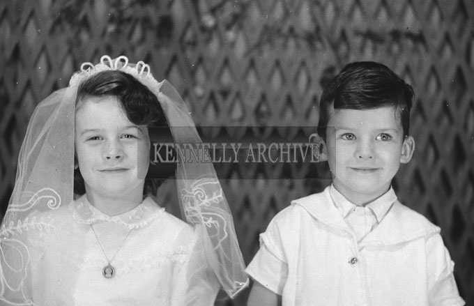 1953; A Studio Photo Of A Communion Girl Posing For The Camera With Her Brother.
