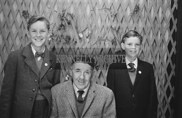 1953; A Studio Photo Of A Father And His Two Sons Posing For The Camera.