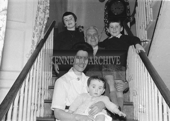 1953; A Photo Of A Family Posing For The Camera At Home.