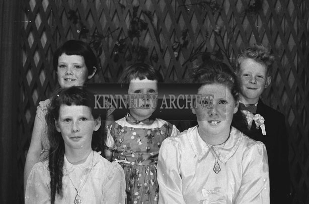 1953; A Studio Photo Of A Family Celebrating Communions And Confirmations.