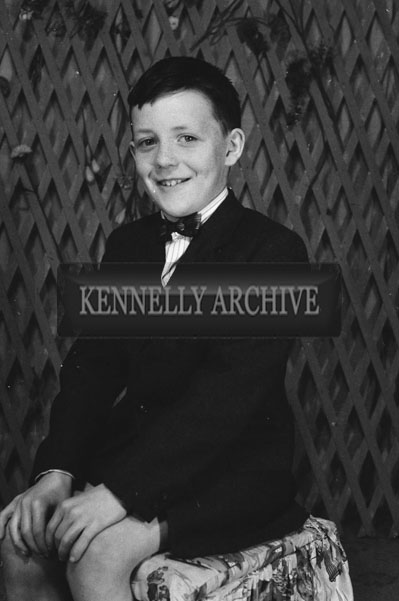 1953; A Studio Photo Of A Boy.