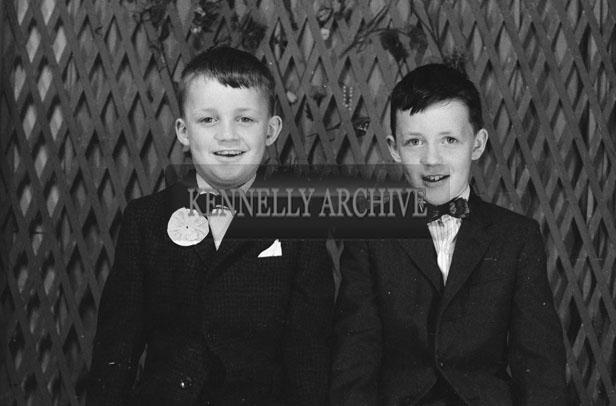 1953; A Studio Photo Of Two Communion Boys.