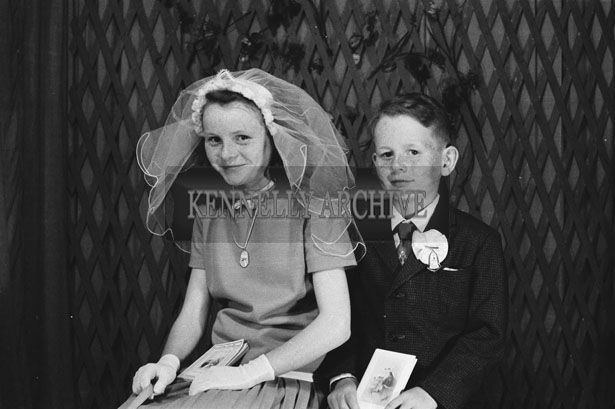 1953; A Studio Photo Of A Communion Boy And A Confirmation Girl Posing For The Camera.